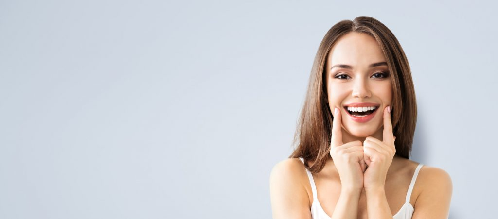 woman smiles after cosmetic dentistry
