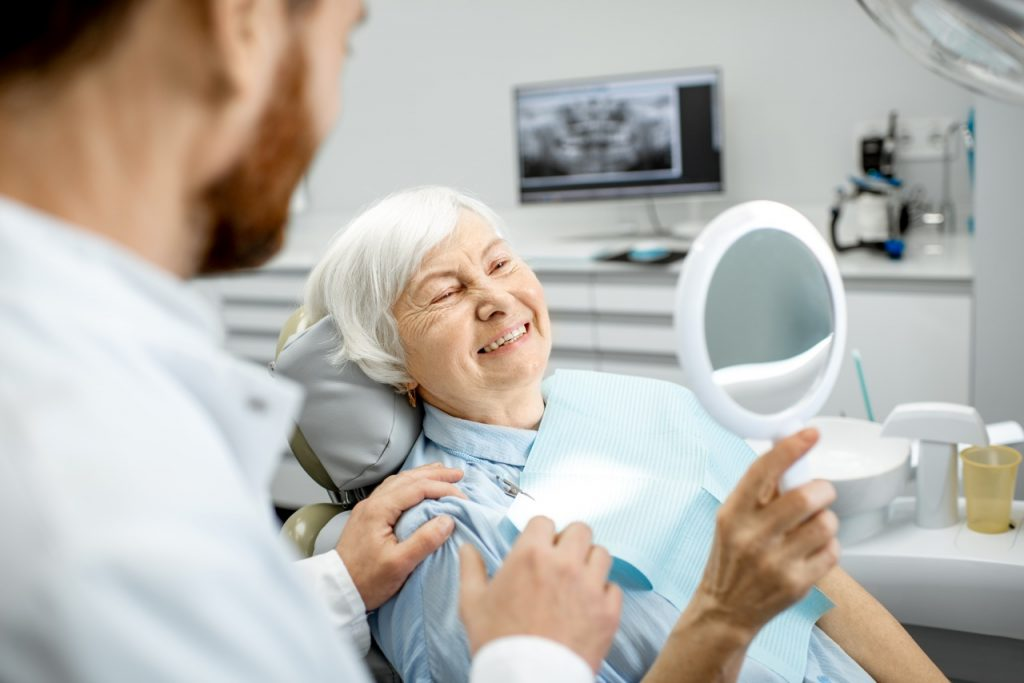 Senior woman smiling with dental implants
